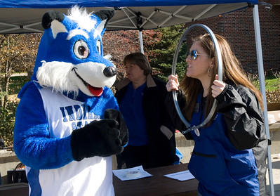Sycamore Sam and senior Megan Randall dance at Jam the Bus while collecting food donations.