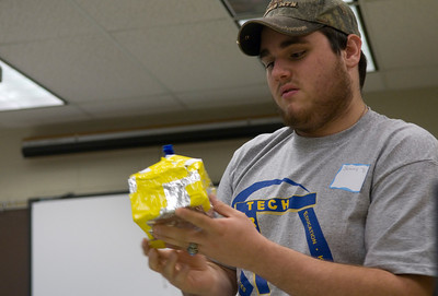 Jeremy Bussing, a junior at Northview, presents the house his team built during the Flood Frenzy event of Tech Trek 2007.