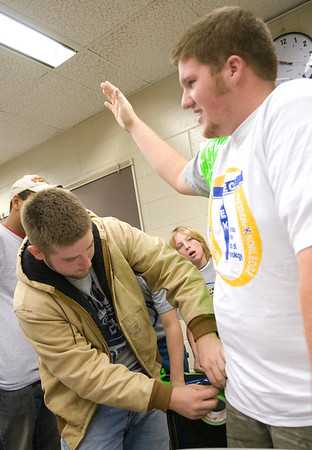 Korey Simonson attaches duct tape to Michael Hall, both of Area 30 Career Center, during the Duct Tape Fanatic competition at Tech Trek 2007.