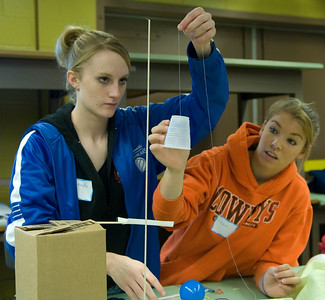 Cassie Cornwell and Miranda Doran, both seniors at Martinsville, compete in the Comical Contraption Challenge.