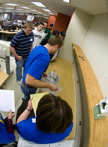 Students from Newcastle High school watch as their model home is tested during the Flood Frenzy event.