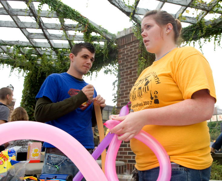 Junior Angie Miller makes balloon animals at Dede Plaza during the 2007 Theatre Fest.
