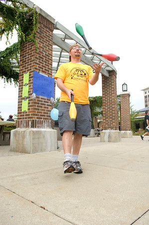 Thiel Munro, a junior, juggles for the people passing by.