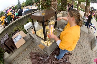 Jolene Long, a graduate student, makes popcorn for students at Theatre Fest 2007.