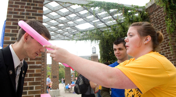 Angie Miller, a junior, places a balloon hat on the head of Cody Boyles, freshman.