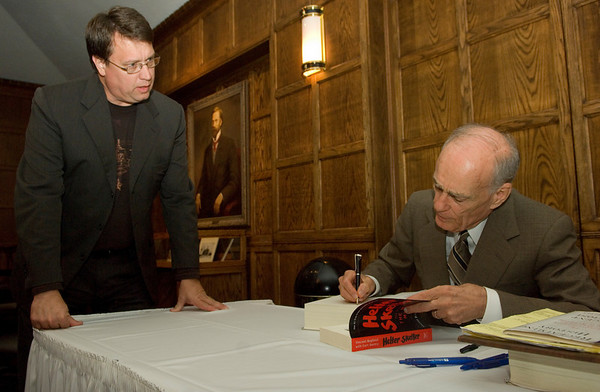 Doctoral student Eugene Sabo has his book signed by Vincent Bugliosi in the Heritage Lounge of Tilson auditorium following Bugliosi's talk about his new book, Reclaiming History.