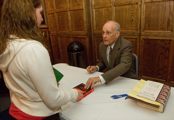 Freshman Kelsey Jones has her book signed by Vincent Bugliosi in the Heritage Lounge of Tilson auditorium following Bugliosi's talk about his new book, Reclaiming History.