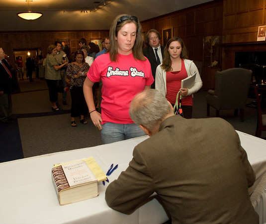 Freshman Casey Ferris has her book signed by Vincent Bugliosi in the Heritage Lounge of Tilson auditorium following Bugliosi's talk about his new book, Reclaiming History.