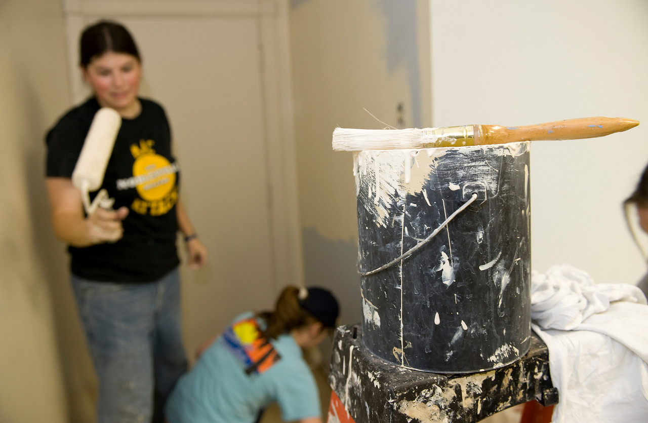 Nikki looks to add more paint while working in Cowan Road Baptist.
