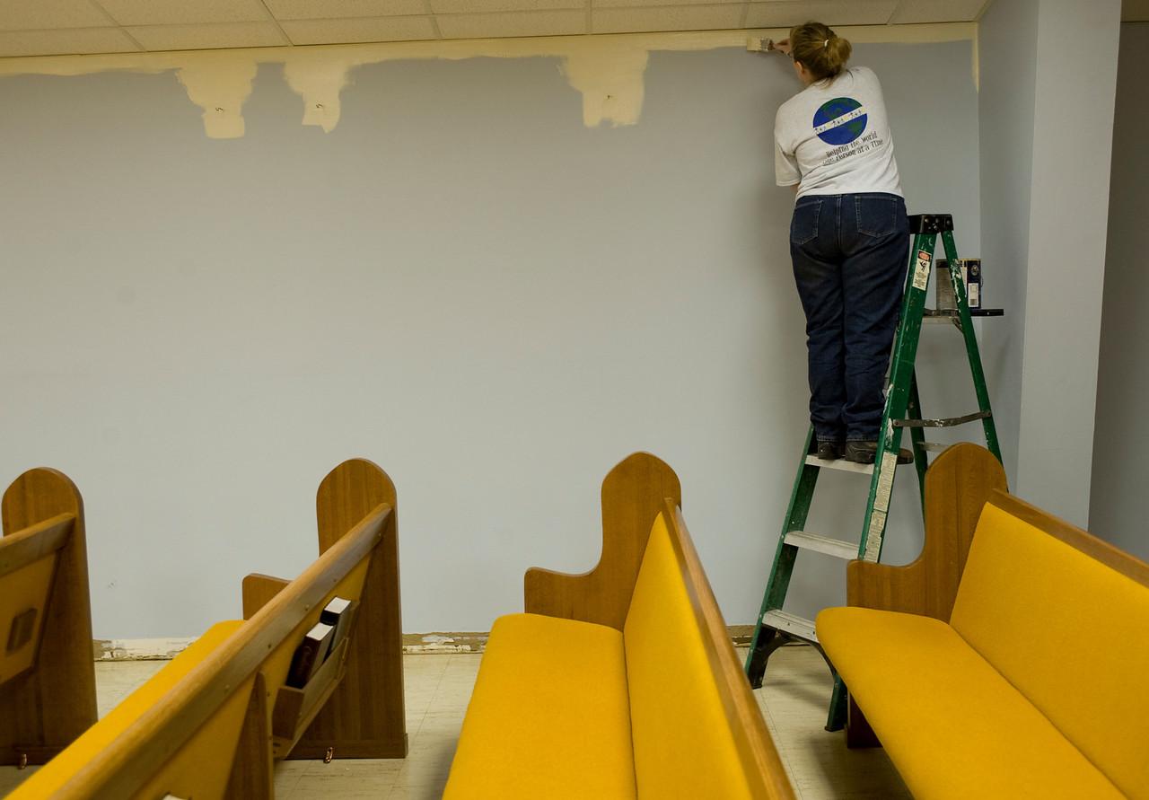 Michelle paints the walls of Cowan Road Baptist Church.
