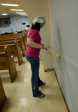 Jessica paints the walls of the church.