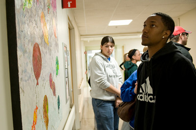 Justin looks over some of the art work created by St. Jude's patients during a tour of the facility.