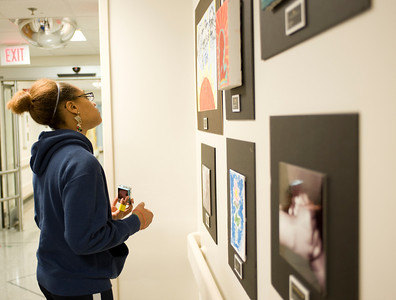 Erica looks at the artwork created by patients that fill a hall at St. Jude.