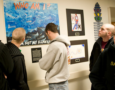 Joe, Ryan and Andrew look at the artwork created by patients that fill a hall at St. Jude.