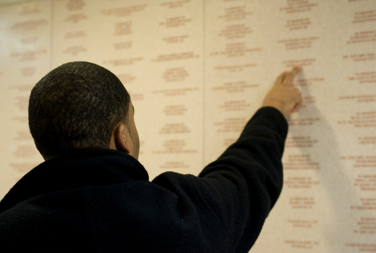 """Jeff Brown points out one of the names on a wall which lists """"Danny's Army"""", the people who helped found St. Jude's."""