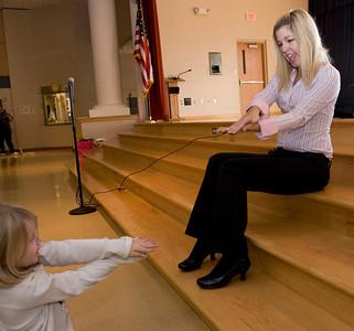 Whitni Hall, Jnr. Elementary Ed Ashley Jones, 5 reading Animal ABC demonstrating how to snap like an alligator