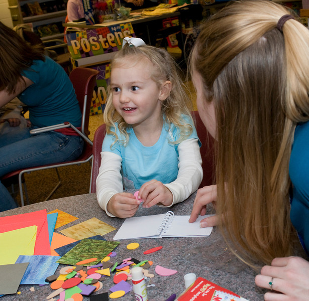 Bonnie Ferree, a junior, helps Sophie Hurst, 3, work on her story idea during the Build-A-Book exercise at the Scholastic Book Fair in the College of Education on Tuesday, January 29, 2008.