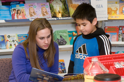 "Sara Buse, sophomore elementary education major, reads an ""I Spy"" nook with Gustavo (last name withheld), 8, who attends second grade at Franklin Elementary as part of the Scholastic Book Fair in the College of Education on Tuesday, January 29, 2008."