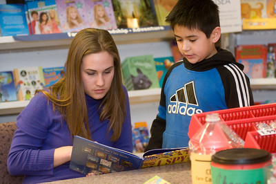 "Sara Buse, sophomore elementary education major, reads an ""I Spy"" nook with Gustavo , 8, who attends second grade at Franklin Elementary as part of the Scholastic Book Fair in the College of Education on Tuesday, January 29, 2008."