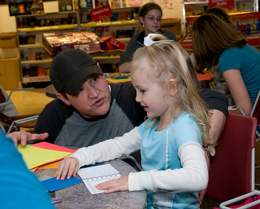 Sophie Hurst, 3, explains her story idea during the Build-A-Book exercise at the Scholastic Book Fair in the College of Education on Tuesday, January 29, 2008.