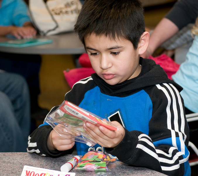 Gustavo, 8, who attends second grade at Franklin Elementary,builds a book as part of the Scholastic Book Fair in the College of Education on Tuesday, January 29, 2008.