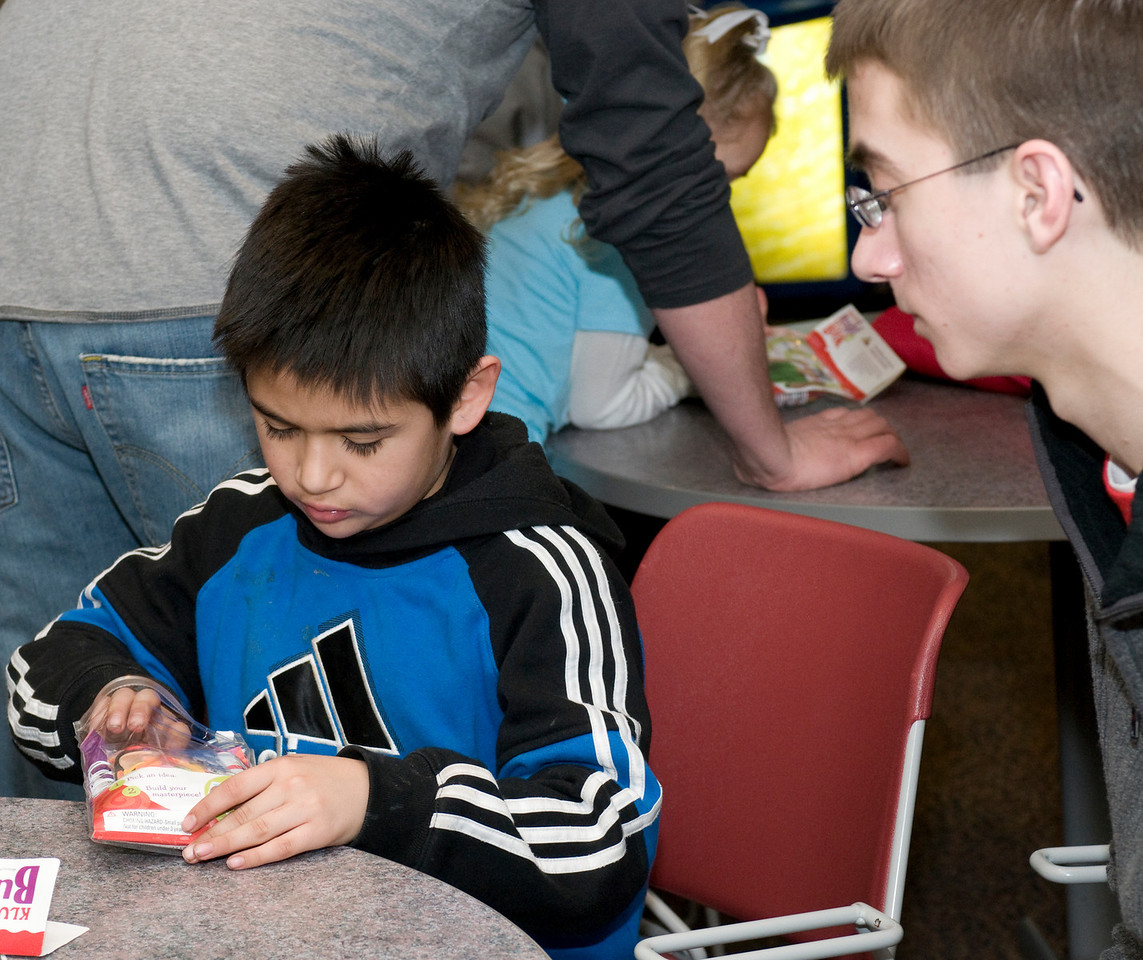 J.D. Miller, sophomore elementary education/ special education major, works with Gustavo, 8, who attends second grade at Franklin Elementary, to Build-A-Book in the College of Education on Tuesday, January 29, 2008.