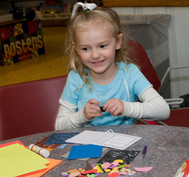 Sophie Hurst, 3, works on her book about Milo the cat during the Build-A-Book exercise at the Scholastic Book Fair in the College of Education on Tuesday, January 29, 2008.