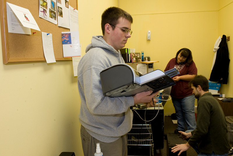 Sean Barry, sophomore helps move office equipment at the Children's Museum.