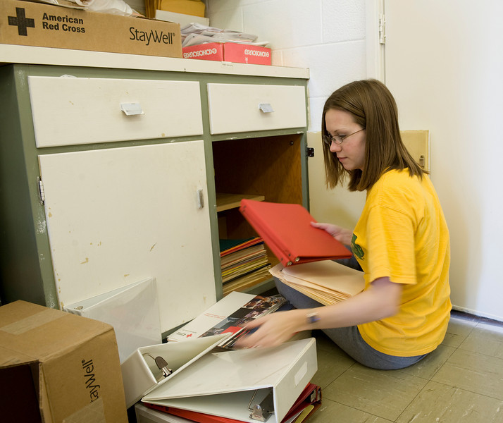 Nicole Gohman, sophomore, organizes office supplies at the American Red Cross.