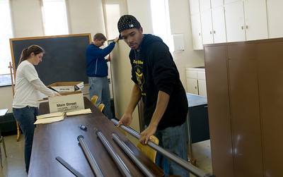 Sean Wright, junior, moves office equipment at the Red Cross while volunteering for his fraternity, Alpha Phi Alpha.