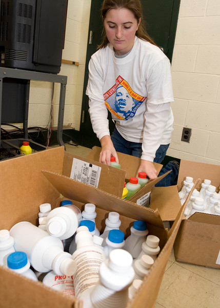Maureen Brown, freshman, boxes up donated materials at the American Red Cross.