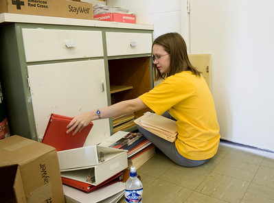 Nicole Gohman, sophomore, organizes office supplies at the American Red Cross