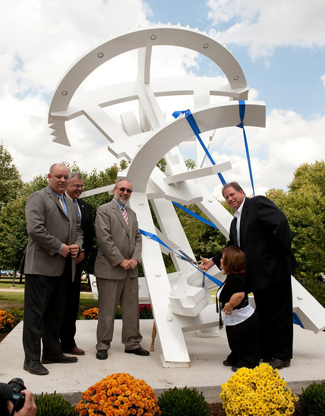 """Arthur's Odyssey"" was created by artist Michael Dunbar and fabricated by 1952 ISU alumna Thelda Livingston Mathews. The white 14-foot stainless steel sculpture is located near the northeast corner of University Hall, the new home of the College of Education."