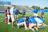 Athletic Training Emergency Drill : Indiana State University athletic training graduate students work with emergency medical technicians at Memorial Stadium on proper techniques for transporting an athlete with a potential spine injury. Student Dave Dziedzicki played the role of an injured football player.  Photos by Kara Berchem