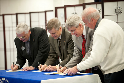 Art Western, vice president at Rose Hulman, Gordon Afdahl, vice president at St. Mary's, William Bruce, chair of the Vigo County Library board, and Robert English, associate vice president at Indiana State sign a memorandum of understanding between the libraries.