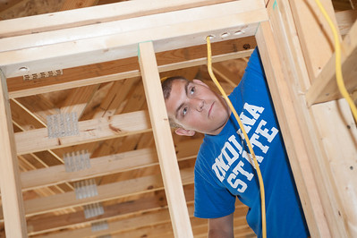 Indiana State students help run wiring inside of the Habitat for Humanity house on Chase Street.