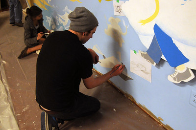 Students paint a mural at the Terre Haute Children's Museum