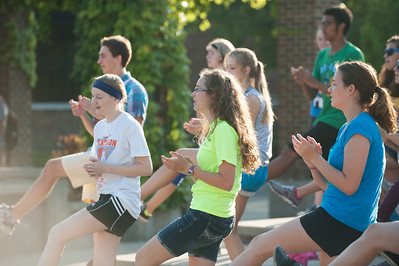 Participants in the 22nd annual Drum Major Clinic warm up before the day's sessions