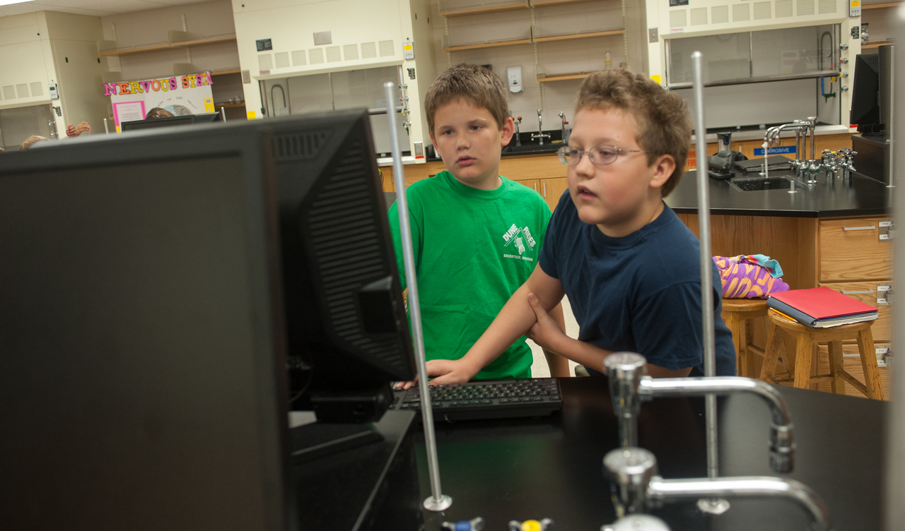 Indiana State students work with youths at the summer science camp