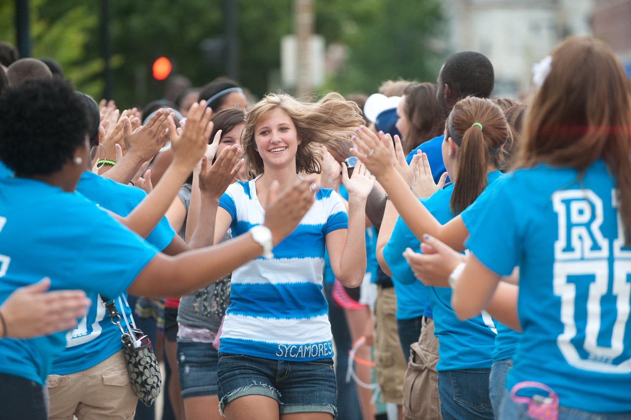 Students in the class of 2016 participate in the traditional March Through the Arch at Oakley Place.