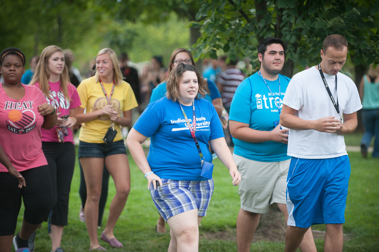 Students gather for icebreakers and a large game of rock, paper, scissors in quad before walking to convocation