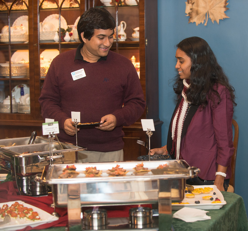 President Dan and Cheri Bradley host a holiday reception for international students at condit house