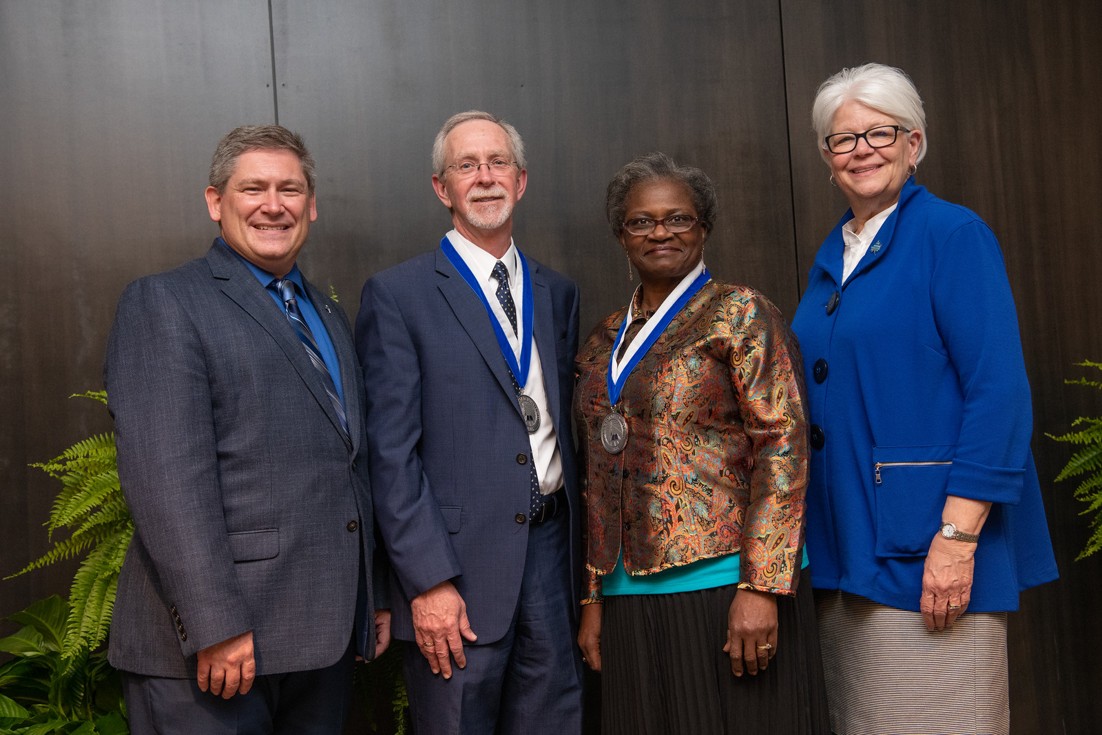 Muyumba, Perrin receive President's Medal