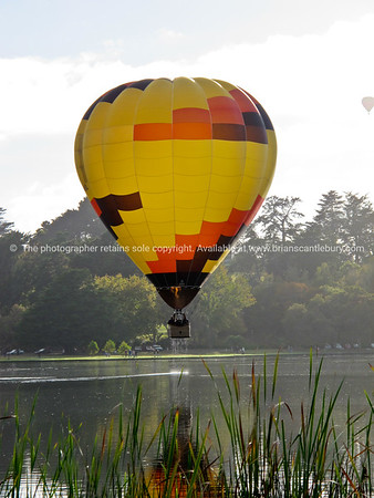 Hot air balloon above lake, Balloons over Waikato, 2010.