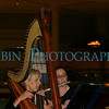 A pair of musicians working a wedding reception.