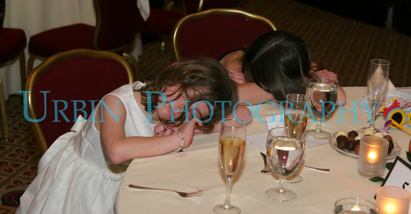 Two young ladies who have enough of the wedding.
