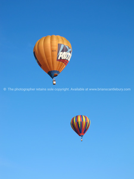 Hot Air Balloons, two against blue sky above Hamilton, Balloons over Waikato, New Zealand, 2010.