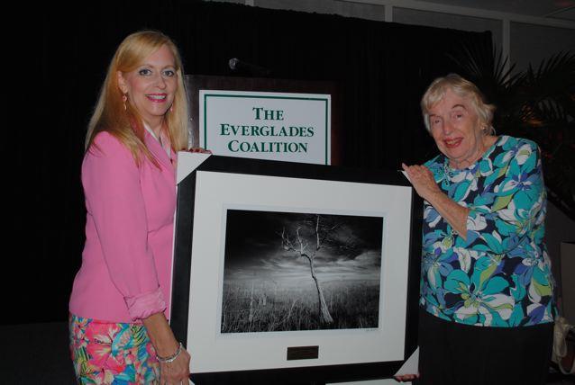 <b>Pauline Stacey and Cynthia Plockelman with Clyde Butcher photo</b> <b>Pauline Presents Cynthia with John V. Kabler Award</b> January 11, 2014 <i>- Maxine Schreiber</i>
