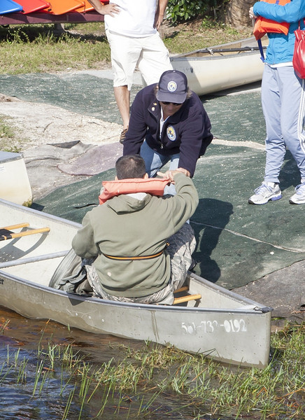 <b>Tom Weidemeyer Helps Visitor Out of Canoe</b>  Everglades Day, February 11, 2012