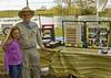 <b>Melaleuca Walking Sticks</b> Frank Skorupa and Great-granddaughter Katelyn at their booth. <i>- Don Mullaney</i>